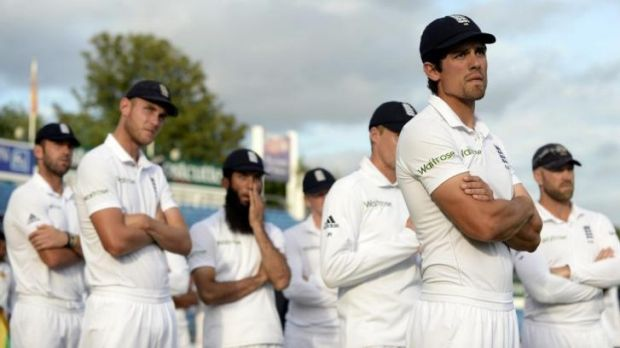 England's captain Alastair Cook and his teammates look on at the presentations after Sri Lanka won the second cricket ...