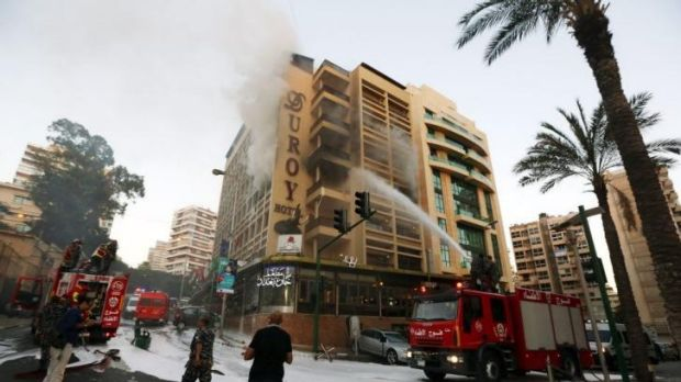 Fire engines work on extinguishing the fire after the blast in Beirut.