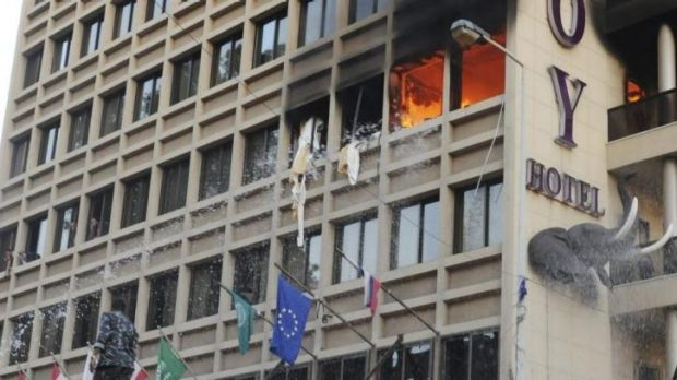 Firefighters put out a fire at Duroy hotel following a bomb attack in Beirut.