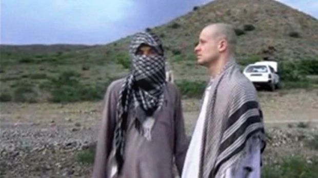 Bowe Bergdahl stands with a Taliban fighter in eastern Afghanistan before his handover.