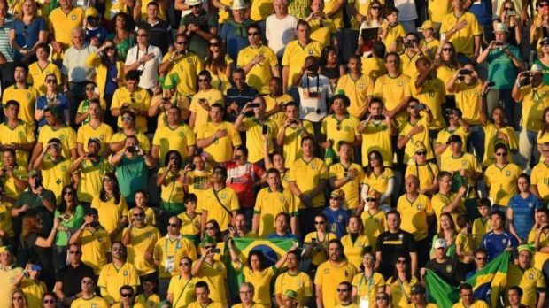 Expect to win ... Brazilian fans sing their national anthem ahead of the Group A football match between Brazil and Croatia