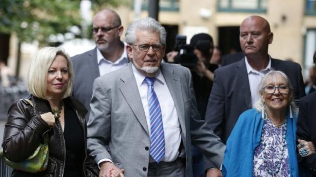 Rolf Harris arrives with his daughter Bindi, left,  and wife Alwen, right, at Southwark Crown Court in London.