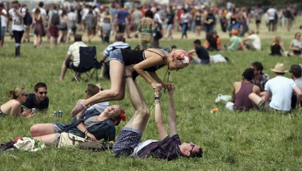 Festival goers are pictured in front of the Pyramid Stage at Worthy Farm in Somerset, on the second day of the ...