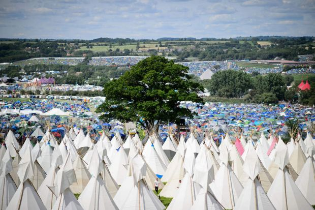 Finishing touches are made to the tipis as the gates open at the Glastonbury Festival.