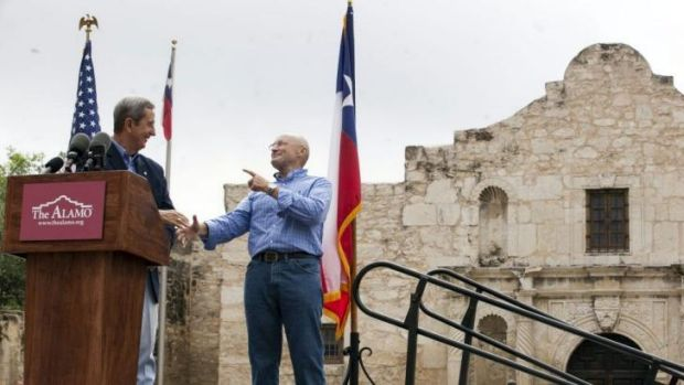 Texas Land Commissioner Jerry Patterson, left, greets Phil Collins in front of the Alamo.