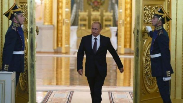 Coming man: Vladimir Putin arrives to address Russia's parliament on Moscow's decision to annex the Crimea.