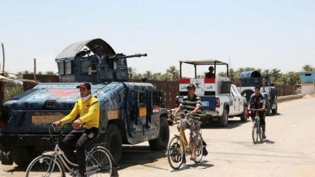 Baghdad belt: Iraqi police patrol in the town of Taji, about 20 kilometres north of the capital.