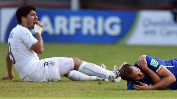 """The tooth hurts: Luis Suarez and Giorgio Chiellini after """"that"""" incident at the World Cup."""
