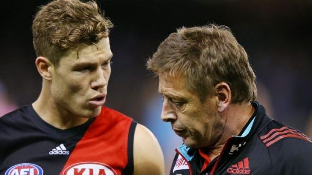 Essendon's Jake Melksham has a word with his coach Mark Thompson during a break.