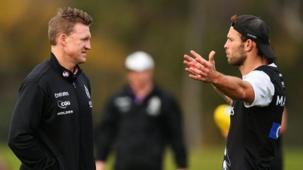 Nathan Buckley talks to Brent Macaffer during a training session.