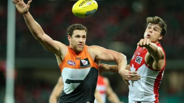 Ruck battle: Giants big man Shane Mumford and Swans counterpart Mike Pyke go head to head.