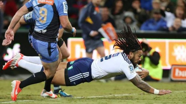 Hair raising: Blues veteran Ma'a Nonu dives over to score in Perth.