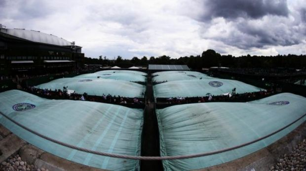 A general view of the rain covers on the outside courts on day six of the Wimbledon on Saturday.