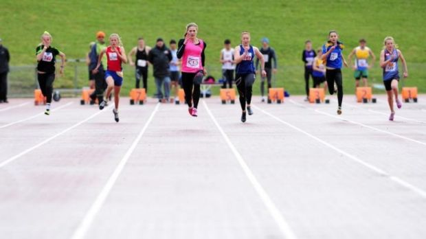 Melissa Breen, centre, ran an impressive 11.35 seconds in wet conditions at the AIS on Sunday.