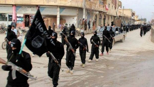 On the march: ISIL fighters parade through Raqa, its northern Syrian headquarters, earlier this month.