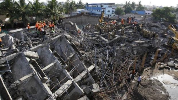 Deadly shelter: Dozens of workers are feared trapped. They had been sheltering from monsoon rains when the building ...