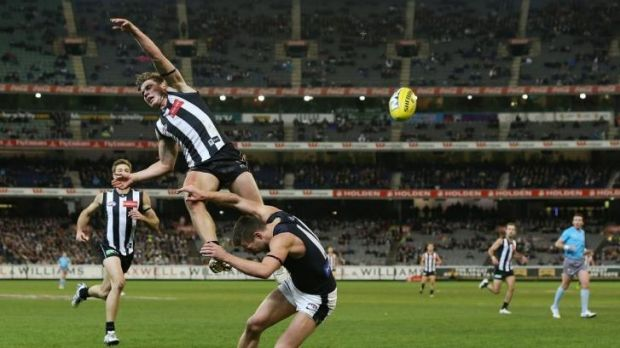 Taylor Adams leaps over Brock McLean during Sunday night's game