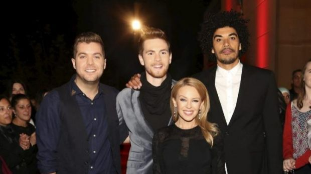 Team Kylie on the read carpet. (L-R) John Lingard, Robbie Balmer, Kylie Minogue and Johnny Rollins.