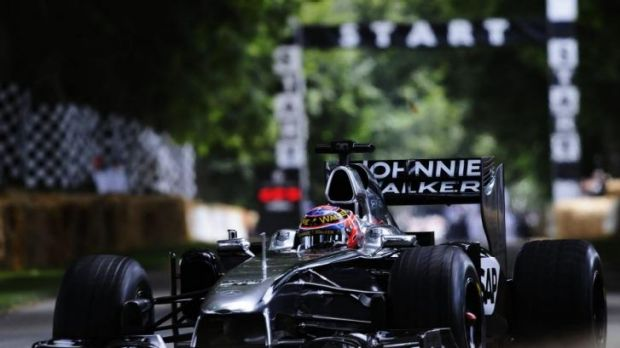 Jenson Button drives the McLaren MP4/26 during the Goodwood Festival of Speed at Goodwood House on Saturday.