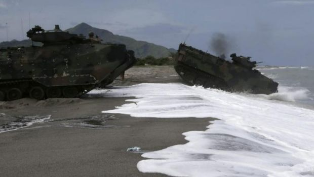 US Navy amphibious assault vehicles roll into the water facing the South China Sea in a joint naval exercise with the ...