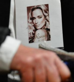A family member holds a picture of Reeva Steenkamp in court.