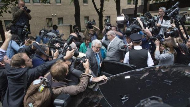 Centre of the storm: Rolf Harris leaves the court as a guilty man.