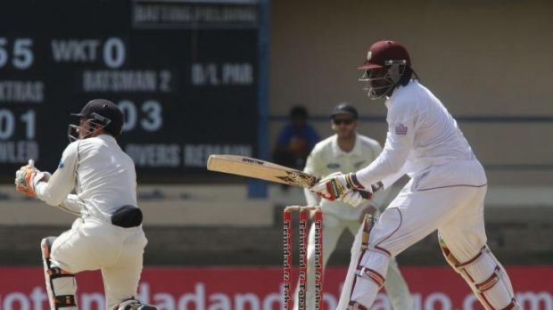New Zealand's wicketkeeper BJ Watling with West Indies opening batsman Chris Gayle.