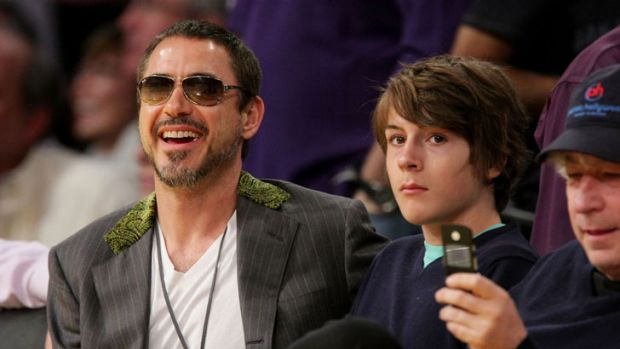 Robert Downey Jr with his son Indio at a basketball game in 2008.