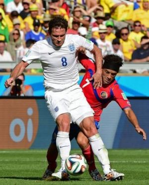England's Frank Lampard (L) in action against Costa Rica's Cristian Bolanos at the World Cup.