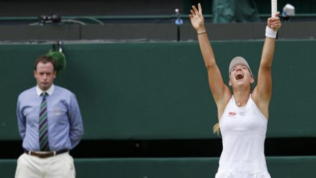 Moment of triumph: Angelique Kerber savours the moment after defeating Maria Sharapova.