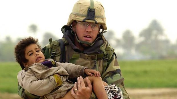 This 2003 image of Joseph Dwyer carrying a young Iraqi boy to safety had represented a heroic view of the US invasion.