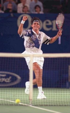 20 Jan 1996: Mark Philippoussis celebrates after winning a point against Pete Sampras in the third round of the ...