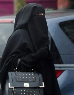 A Frenchwoman wearing a niqab in Roubaix in January. Hundreds of women have been fined for breaching France's ...