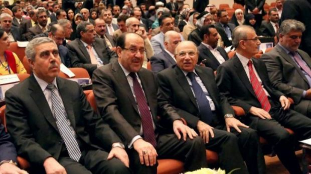 Iraq's Prime Minister Nouri al-Maliki, second left, attends the first session of parliament.