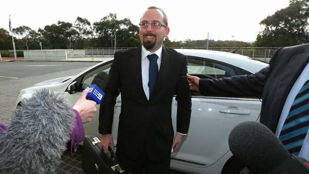Important brief: Senator Ricky Muir arrives at Parliament House to meet Prime Minister Tony Abbott on Wednesday.