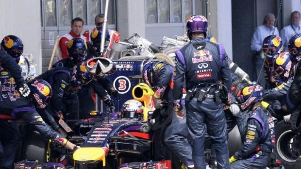 Mechanical machinations: Sebastian Vettel gets some pit-stop assistance during the Austrian F1 Grand Prix