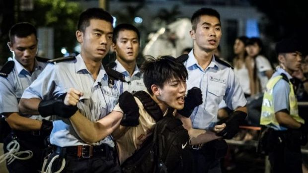 Police remove protesters in the central district: Pro-democracy rally.