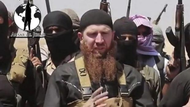 Islamic State of Iraq and the Levant leader Omar al-Shishani stands among a group of fighters as they declare the ...