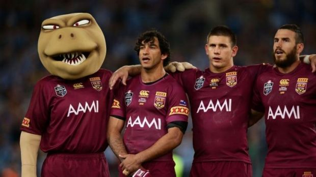 Maroons Johnathan Thurston, Jacob Lillyman and Darius Boyd sing the national anthem before game two of the State of ...