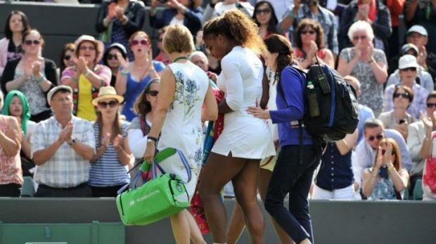 Serena Williams is assisted from the court.