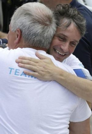 Cousteau hugged by a member of his team as he returns to the dock after 31 days undersea in the Aquarius Reef Base.