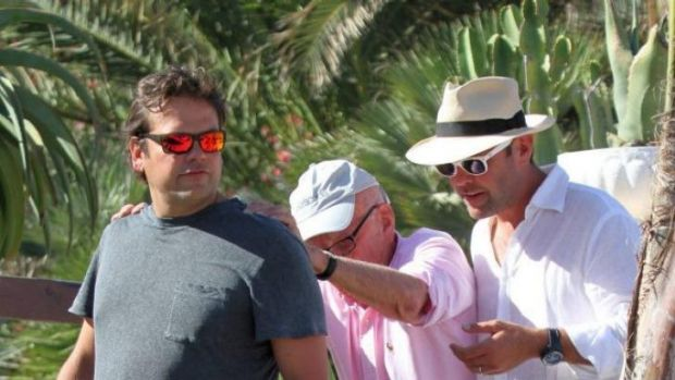 Easy does it: Lachlan, Rupert and James Murdoch in Greece.