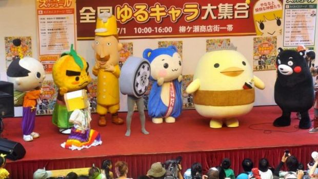 """Yuru-kyara"", or ""laid-back characters"", performing at the Yanagase shopping district in Gifu."