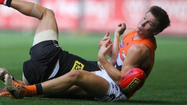 Toby Greene of the GWS Giants drops a chest mark against St Kilda in March.