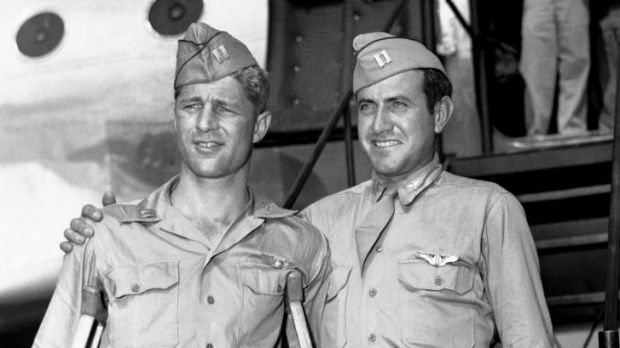 Arriving home ... Captain Louis Zamperini (right) and Captain Fred Garrett who were adrift 47 days in the Pacific after ...