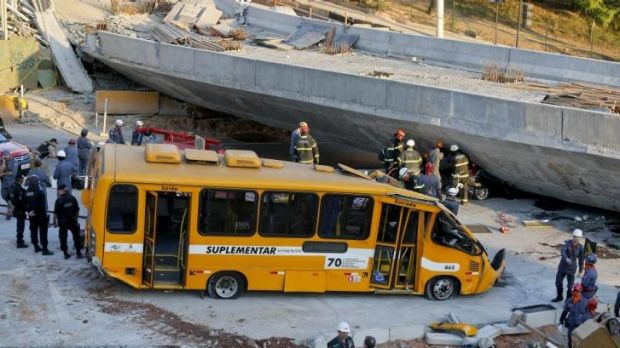 A bus sits damaged after a bridge collapsed in Belo Horizonte, Brazil.
