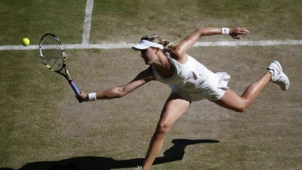 Canada's Eugenie Bouchard returns a backhand to Romania's Simona Halep.