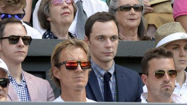Actor Jim Parsons watches from the players box.