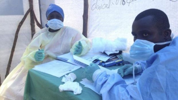 Health workers administer blood tests for the ebola virus in Kenema, Sierra Leone.