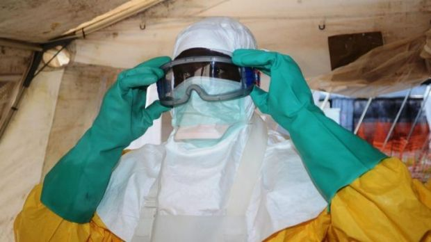A member of  Medecins Sans Frontieres in the isolation ward of Donka Hospital in Conakry, Guinea.